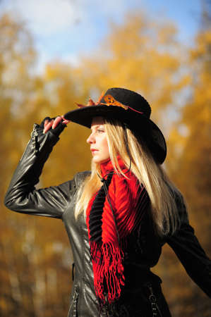 the girl in a cowboy s hat in the autumn photo