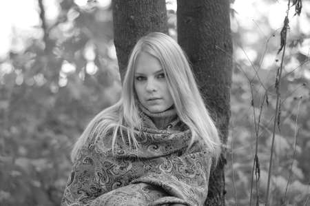 young blond woman in autumn park photo