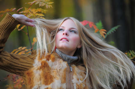 young blond woman in autumn park
