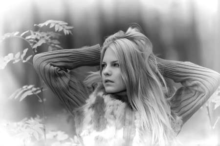 beautiful young blond woman in autumn park photo