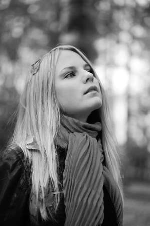 beautiful young blond woman in autumn park