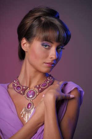 Charming brunette model posing, studio shot photo
