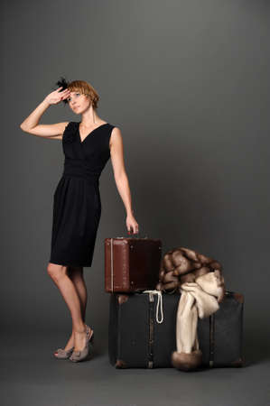 Woman with suitcases. Retro Stock Photo - 10921271