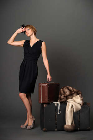 Woman with suitcases. Retro Stock Photo - 10908841