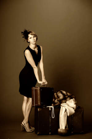 Woman with suitcases. Retro photo