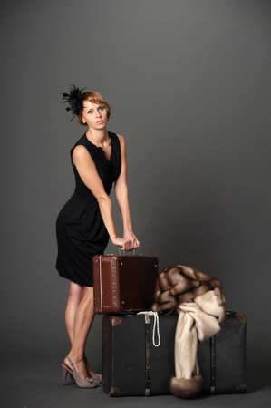 Woman with suitcases. Retro Stock Photo - 10921273