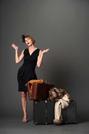 Woman with suitcases. Retro Stock Photo - 10921270