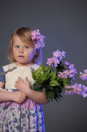five petals: little girl with a bouquet of lilacs
