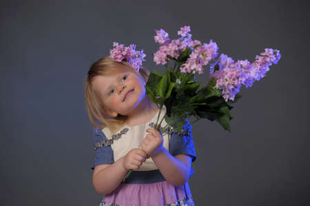 little girl with a bouquet of lilacs Stock Photo - 10448110