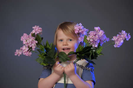 little girl with a bouquet of lilacs Stock Photo - 10448115