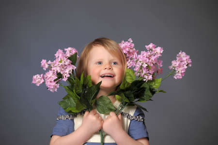 little girl with a bouquet of lilacs photo