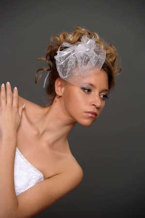 Stylish studio portrait of a beautiful young woman photo