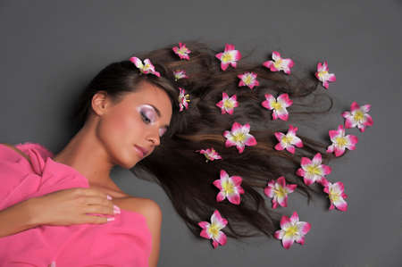 girl with flowers in their hair photo