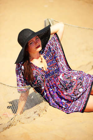 young woman in a wide-brimmed hat on the beach Stock Photo - 10829687