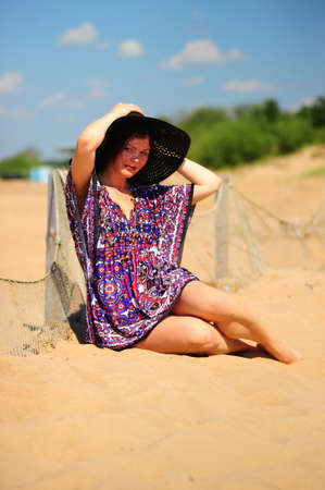 young woman in a wide-brimmed hat on the beach Stock Photo - 10829677