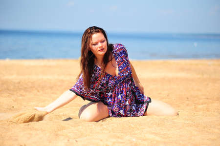 woman playing with sand photo