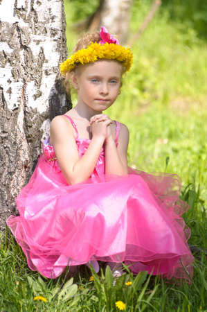 girl with a wreath of dandelions photo