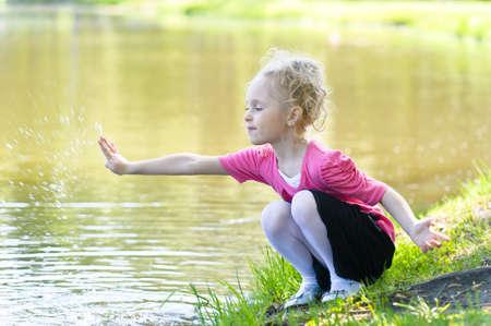 blonde little girl: Girl near lake