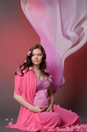 beautiful pregnant woman in the pink photo