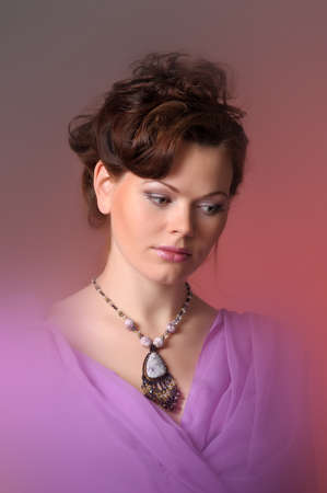girl beautiful stone necklace around his neck photo