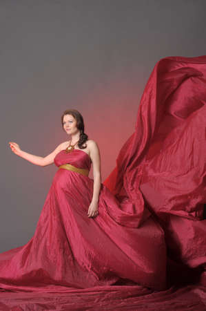 Pregnant woman in red dress  Stock Photo - 14428841