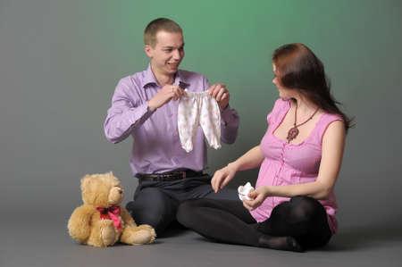 Happy pregnant couple photo