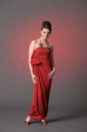 The beautiful girl in a long red dress  Stock Photo - 11422319