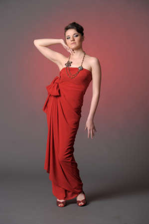 The beautiful girl in a long red dress  Stock Photo - 11422320