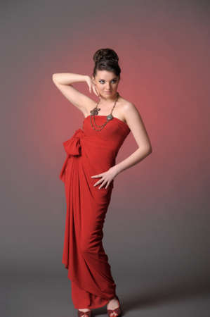 The beautiful girl in a long red dress Stock Photo - 11422318