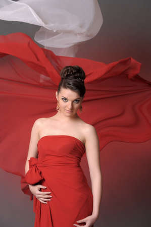The beautiful girl in a long red dress Stock Photo - 11422327