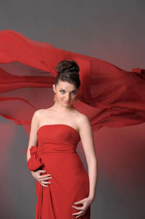 The beautiful girl in a long red dress  Stock Photo - 11422326
