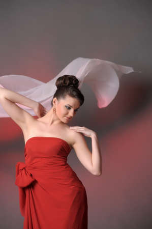 The beautiful girl in a long red dress Stock Photo - 11422323