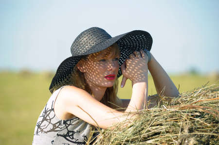 young woman in a wide-brimmed hat Stock Photo - 10583951