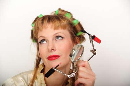 girl doing makeup photo