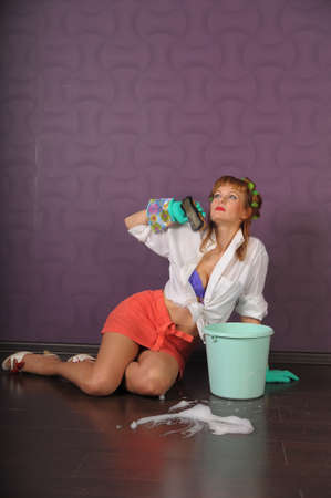 Housewife is cleaning the floor Stock Photo - 10095505