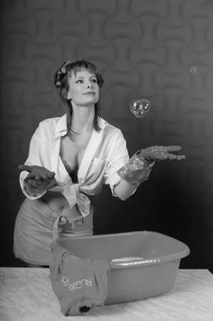 Housewife wash clothes in the basin  Photo taken in the pin up Stock Photo - 13235331
