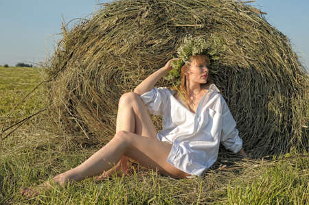 holiday maker: blonde in a haystack