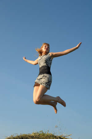 Young woman flying photo