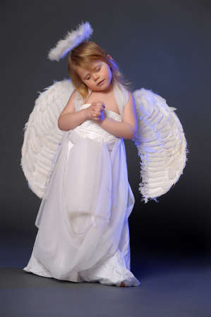 Girl in angel costume photo