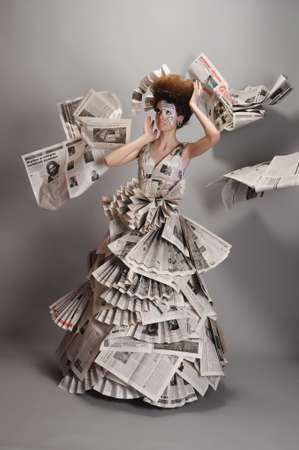 periodicals: Girl in the newspaper