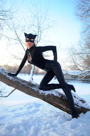 latex fetish: Beautiful young woman wearing catsuit and mask