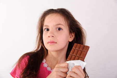 girl in pink with chocolate photo