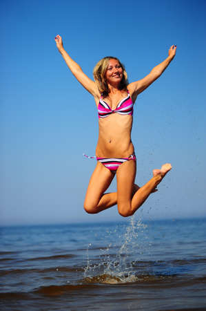 girl jumping in the water photo