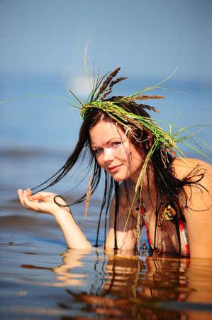 Girl having fun in the water photo