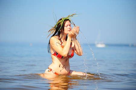 adult mermaid: Girl having fun in the water