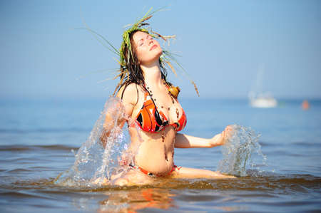 Girl having fun in the water photo