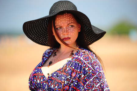 young woman in a big hat. photo