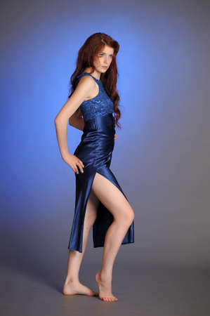 Young slim woman in blue dress photo