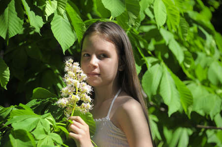 girl with a blooming chestnut tree