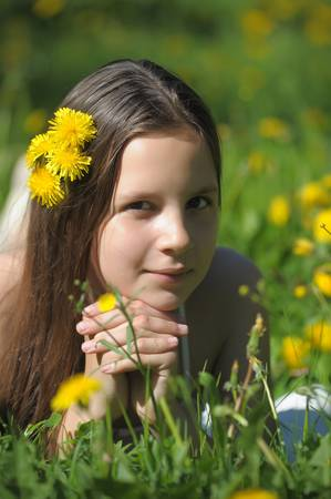 girl in the middle of dandelions photo